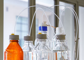 picture of chromatography  - Close up clear and amber color bottle with plastic hose for High performance liquid chromatography  - JPG