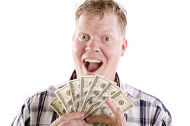 pic of holding money  - A blond man with an excited face and a handful of fanned money - JPG