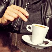 pic of e-cig  - closeup of a young man with an electronic cigarette and a cup of coffee in the terrace of a cafe - JPG