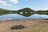 picture of barbie  - BBQ ashes by beautiful lake on calm idyllic summer morning with cloud reflections - JPG