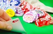 stock photo of poker hand  - poker game cards in hand - JPG
