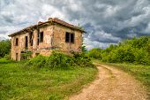 stock photo of abandoned house  - Image of an old abandoned house before the storm - JPG