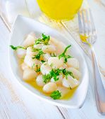 picture of scallops  - scallop with oil on the plate and on a table - JPG