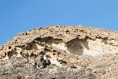 stock photo of sedimentation  - Eroding rocks and sediments in Fuerteventura at the coast - JPG