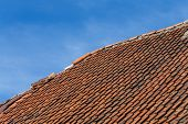 image of roofs  - Broken terracotta tile on a roof of old house - JPG