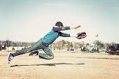 image of leaping  - Boy leaping to catch a baseball - JPG