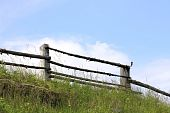 pic of split rail fence  - Split rail fence against the blue sky and a green grass - JPG