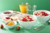 picture of quinoa  - healthy breakfast quinoa with strawberry banana coconut flakes - JPG