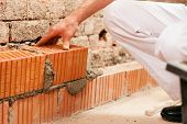 picture of grout  - bricklayer laying - JPG