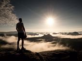 Man At The Top Of A Mountain Looking The Misty Landscape. Feel Free poster