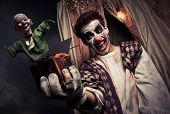 stock photo of jack-in-the-box  - scary clown holding a Jack - JPG