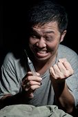 picture of ecstacy  - Happy drug addict with syringe in hand - JPG