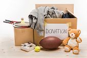 Cardboard Boxes With Donation Clothes And Different Objects On White, Donation Concept poster