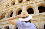 Young Female Traveler Looking On Famous The Colosseum In Rome. Sightseeing Tour In Italy poster