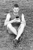 Set Up Application. Sportsman With Smartphone And Pedometer Prepare For Jog. How Set Up Route For Jo poster