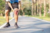 Young Fitness Man Holding His Sports Leg Injury. Muscle Painful During Training. Asian Runner Having poster