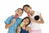 Siblings Eating Ice Creams
