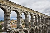 The well-known antique aqueduct and ancient Segovia in cloudy May day poster