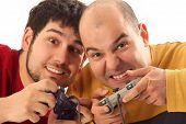image of video game controller  - Two young men playing video game console controller - JPG