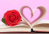 Page Of Book Curved  Heart Shape And Red Rose poster