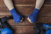 Mens Fists In Boxing Taping On A Wooden Background With Boxing Gloves. The Concept Of Training For B poster