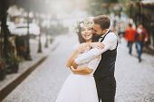 Handsome Loving Couple, Wife And Husband, Hugs Tender His Wife From Back In The Street poster