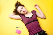 stock photo of friendship belt  - young woman on yellow - JPG