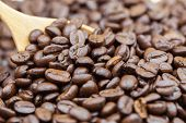 Coffee Beans Texture Or Coffee Beans Background With Wooden Spoon Background. Brown Roasted Coffee B poster