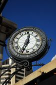 picture of olden days  - Beautiful old clock in downtown business distirct - JPG