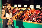 stock photo of candid  - Woman buying fruits and vegetables at farmers market - JPG