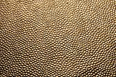 stock photo of stippling  - Burnished textured copper backgorund with a rough beaded surface in a random pattern - JPG