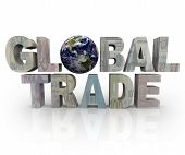 stock photo of international trade  - The words Global Trade with world currencies printed on them - JPG