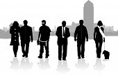 stock photo of walking away  - Silhouette people walking away from the city - JPG