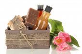 stock photo of crate  - Composition of cosmetic bottles and soap in crate - JPG