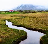 Green Iceland landscape Snaefellsnes rural scenics volcano in overcast sky beautiful travel and tourism Icelandic wilderness solitude and remote house poster