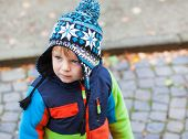 Portrait Of Toddler Boy In Winter Clothes