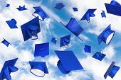 pic of graduation hat  - Graduation caps fly in the air in a moment of celebration - JPG