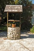 stock photo of wishing-well  - wishing well at Cobblestone VillageGreytown New Zealand - JPG