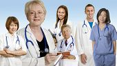 image of doctors office  - Doctors and Nurses standing with background of blue gradient - JPG