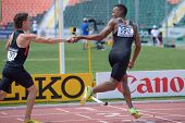 DONETSK, UKRAINE - JULY 13: Jake Hanna pass the baton to Cameron Nurse, Canada, in the boys medley r