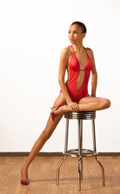 stock photo of monokini  - Young slender female fashion model of mixed Creole and African - JPG