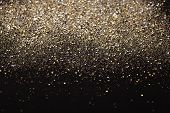 foto of xmas star  - Gold and silver glitter abstract background isolated on black - JPG