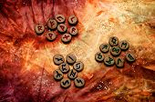 stock photo of rune  - set of wooden runes an ancient alphabet known as the futhark are divided into the three aetts on a colorful hand dyed fabric with small sparkling beads - JPG