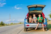 picture of road trip  - three happy kids in car - JPG