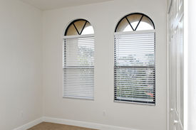 pic of windows doors  - an empty room with arched windows and closed clost doors - JPG