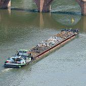 foto of barge  - Barge transports waste on the river - JPG