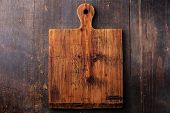 picture of cutting board  - Chopping cutting board on dark wooden background - JPG