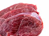 picture of flank steak  - Macro closeup of leg lamb meat steaks isolated on white - JPG