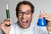 stock photo of mad scientist  - Mad scientist holding chemicals in test tube - JPG
