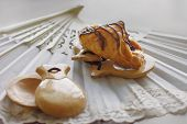 stock photo of castanets  - pastries and flamenco accessories? fan and castanets